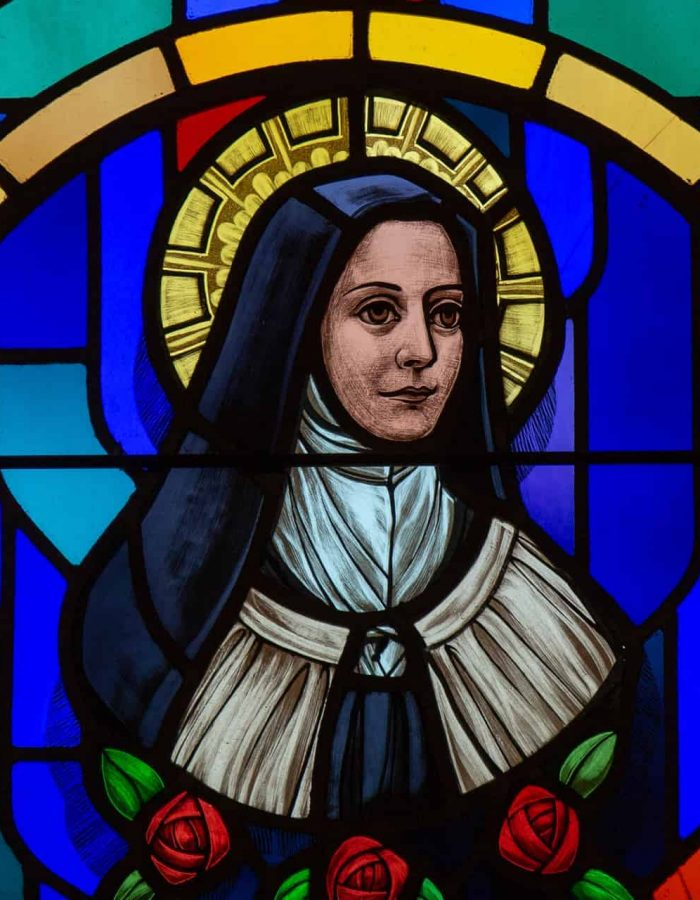 A stained glass window portrait of St. Thérèse of Lisieux at Little Flower Catholic Church in Pensacola, Florida
