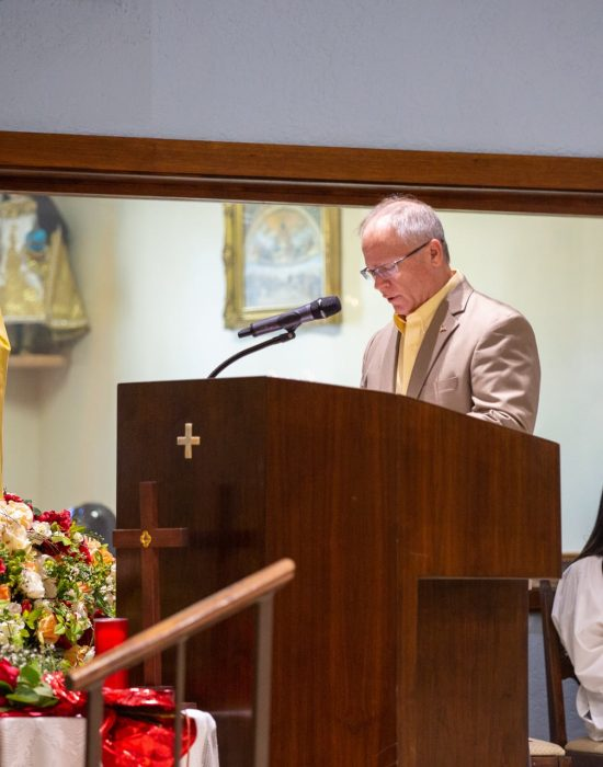 Lector standing at the pulpit