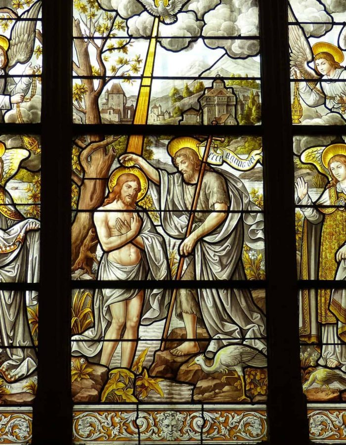 Stained glass depiction of Jesus being baptized in the Jordan by John the Baptist